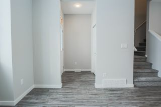 Photo 4: 1210 Rosenthal Boulevard in Edmonton: Zone 58 Attached Home for sale : MLS®# E4187828