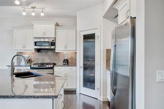 Photo 5: 15 ASPEN HILLS Manor SW in Calgary: Aspen Woods Detached for sale : MLS®# A1018842