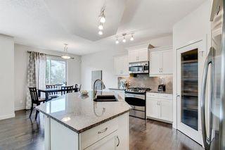 Photo 12: 15 ASPEN HILLS Manor SW in Calgary: Aspen Woods Detached for sale : MLS®# A1018842