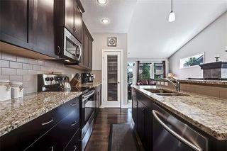 Photo 7: 545 BOULDER CREEK Green S: Langdon Semi Detached for sale : MLS®# A1029406