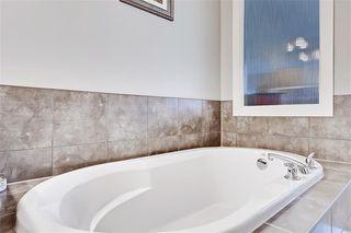 Photo 18: 545 BOULDER CREEK Green S: Langdon Semi Detached for sale : MLS®# A1029406
