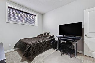 Photo 32: 545 BOULDER CREEK Green S: Langdon Semi Detached for sale : MLS®# A1029406