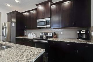 Photo 8: 545 BOULDER CREEK Green S: Langdon Semi Detached for sale : MLS®# A1029406