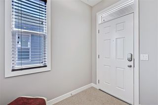 Photo 2: 545 BOULDER CREEK Green S: Langdon Semi Detached for sale : MLS®# A1029406