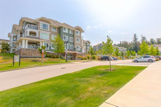 "Photo 1: 317 16398 64 Avenue in Surrey: Cloverdale BC Condo for sale in ""THE RIDGE AT BOSE FARMS"" (Cloverdale)  : MLS®# R2476395"