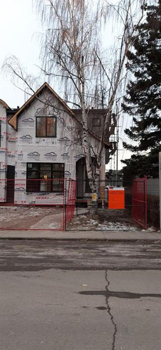 Photo 4: 2109 52 Avenue SW in Calgary: North Glenmore Park Semi Detached for sale : MLS®# A1047157