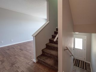 Photo 19: 450 130 New Brighton Way SE in Calgary: New Brighton Row/Townhouse for sale : MLS®# A1057507