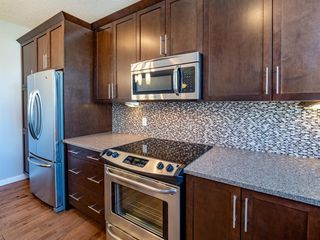 Photo 9: 450 130 New Brighton Way SE in Calgary: New Brighton Row/Townhouse for sale : MLS®# A1057507