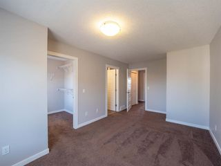 Photo 23: 450 130 New Brighton Way SE in Calgary: New Brighton Row/Townhouse for sale : MLS®# A1057507