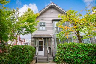 Photo 1: 4877 DUCHESS STREET in Vancouver: Collingwood VE Townhouse for sale (Vancouver East)  : MLS®# R2408355