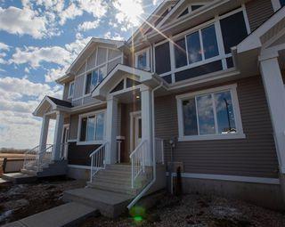 Photo 2: 8504 96 Avenue: Morinville Attached Home for sale : MLS®# E4210849