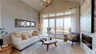 Photo 10: 12558 Crestmont Boulevard SW in Calgary: Crestmont Row/Townhouse for sale : MLS®# C4306311