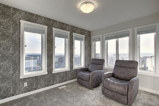 Photo 20: 107 LUCAS Boulevard NW in Calgary: Livingston Row/Townhouse for sale : MLS®# A1057389