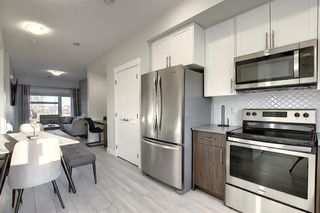 Photo 5: 107 LUCAS Boulevard NW in Calgary: Livingston Row/Townhouse for sale : MLS®# A1057389