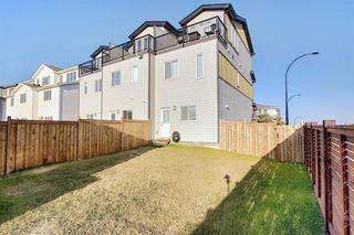 Photo 30: 107 LUCAS Boulevard NW in Calgary: Livingston Row/Townhouse for sale : MLS®# A1057389