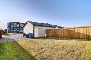 Photo 32: 107 LUCAS Boulevard NW in Calgary: Livingston Row/Townhouse for sale : MLS®# A1057389