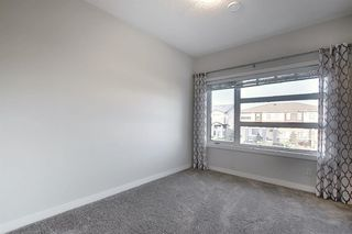 Photo 16: 107 LUCAS Boulevard NW in Calgary: Livingston Row/Townhouse for sale : MLS®# A1057389