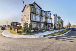 Main Photo: 107 LUCAS Boulevard NW in Calgary: Livingston Row/Townhouse for sale : MLS®# A1057389