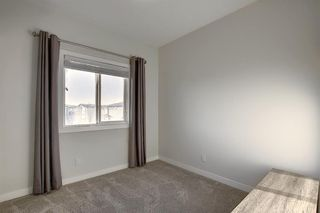 Photo 18: 107 LUCAS Boulevard NW in Calgary: Livingston Row/Townhouse for sale : MLS®# A1057389