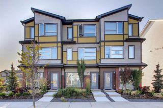 Photo 2: 107 LUCAS Boulevard NW in Calgary: Livingston Row/Townhouse for sale : MLS®# A1057389