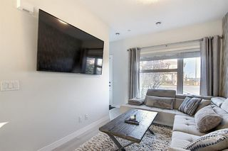 Photo 10: 107 LUCAS Boulevard NW in Calgary: Livingston Row/Townhouse for sale : MLS®# A1057389