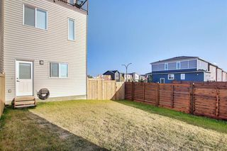 Photo 31: 107 LUCAS Boulevard NW in Calgary: Livingston Row/Townhouse for sale : MLS®# A1057389