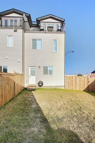 Photo 29: 107 LUCAS Boulevard NW in Calgary: Livingston Row/Townhouse for sale : MLS®# A1057389