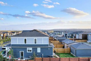 Photo 4: 107 LUCAS Boulevard NW in Calgary: Livingston Row/Townhouse for sale : MLS®# A1057389
