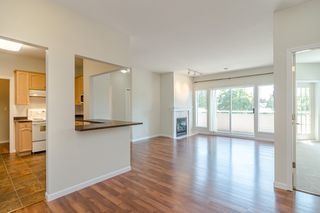 Photo 1: 209 21975 49 Avenue in Langley: Murrayville Condo for sale : MLS®# r2390189