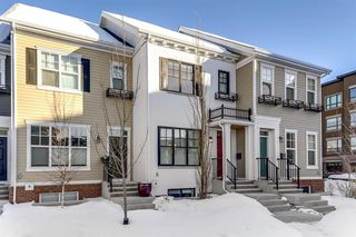 Main Photo: 153 Burma Star Road SW in Calgary: Currie Barracks Row/Townhouse for sale : MLS®# A1057078