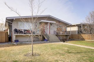 Photo 2: 2117 + 2119 4 AV NW in Calgary: West Hillhurst House for sale : MLS®# C4238056