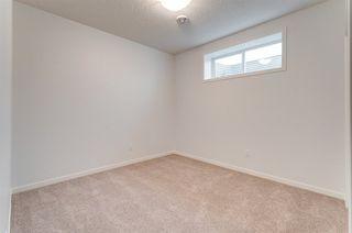 Photo 39: 807 176 Street in Edmonton: Zone 56 House for sale : MLS®# E4218613