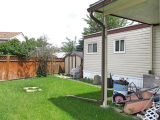 Photo 14: 106 Home Bay SE: High River Mobile for sale : MLS®# A1010711
