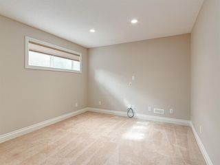 Photo 23: 292 QUARRY PARK Boulevard SE in Calgary: Douglasdale/Glen Row/Townhouse for sale : MLS®# A1019279