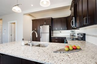 Photo 7: 1701 1086 WILLIAMSTOWN Boulevard NW: Airdrie Row/Townhouse for sale : MLS®# A1028337