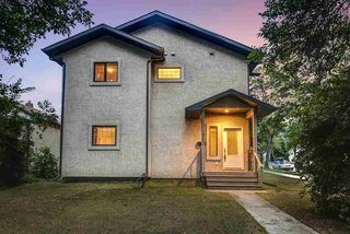 Photo 1: 9003 91 Street in Edmonton: Zone 18 Duplex Front and Back for sale : MLS®# E4172642