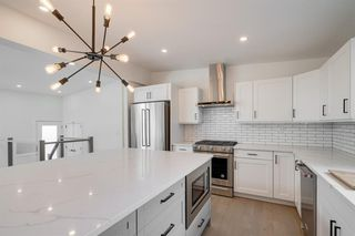 Photo 5: 4908 BROCKINGTON Road NW in Calgary: Brentwood Detached for sale : MLS®# A1032247