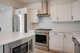Photo 7: 4908 BROCKINGTON Road NW in Calgary: Brentwood Detached for sale : MLS®# A1032247