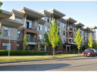 "Photo 1: 202 33545 RAINBOW Avenue in Abbotsford: Abbotsford East Condo for sale in ""Tempo"" : MLS®# R2447343"