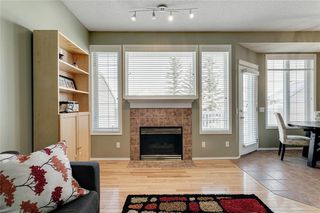 Photo 3: 74 INVERNESS Square SE in Calgary: McKenzie Towne Row/Townhouse for sale : MLS®# A1017936