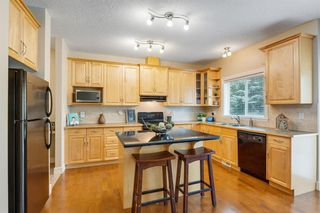 Photo 11: 23 39 Strathlea Common SW in Calgary: Strathcona Park Semi Detached for sale : MLS®# A1036535