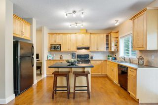 Photo 10: 23 39 Strathlea Common SW in Calgary: Strathcona Park Semi Detached for sale : MLS®# A1036535