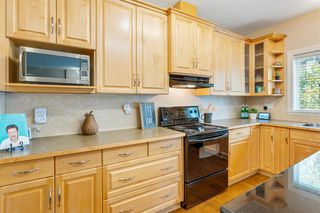 Photo 12: 23 39 Strathlea Common SW in Calgary: Strathcona Park Semi Detached for sale : MLS®# A1036535