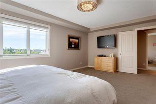 Photo 19: 22 ASPEN SUMMIT Green SW in Calgary: Aspen Woods Detached for sale : MLS®# C4303716