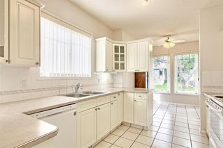 Photo 2: 14 SIGNAL HILL Lane SW in Calgary: Signal Hill Semi Detached for sale : MLS®# A1034510
