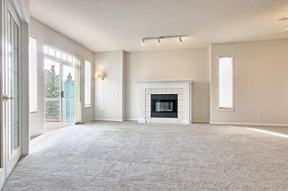 Photo 9: 14 SIGNAL HILL Lane SW in Calgary: Signal Hill Semi Detached for sale : MLS®# A1034510