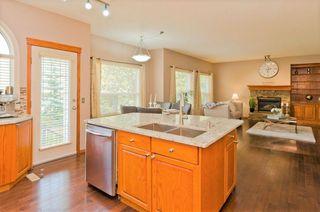 Photo 7: 9 250 Rocky Ridge Drive NW in Calgary: Rocky Ridge Detached for sale : MLS®# A1040761