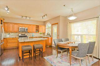 Photo 4: 9 250 Rocky Ridge Drive NW in Calgary: Rocky Ridge Detached for sale : MLS®# A1040761