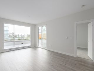 "Photo 4: 104 1768 GILMORE Avenue in Burnaby: Brentwood Park Condo for sale in ""Escala"" (Burnaby North)  : MLS®# R2398729"