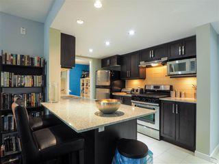 "Photo 3: 412 1212 MAIN Street in Squamish: Downtown SQ Condo for sale in ""Aqua"" : MLS®# R2465181"